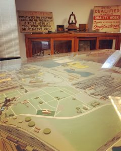 A large diorama and historic painted signs related to the steel industry
