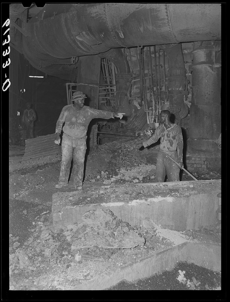 A black and white photo of two African American men working in the Sparrows Point mill