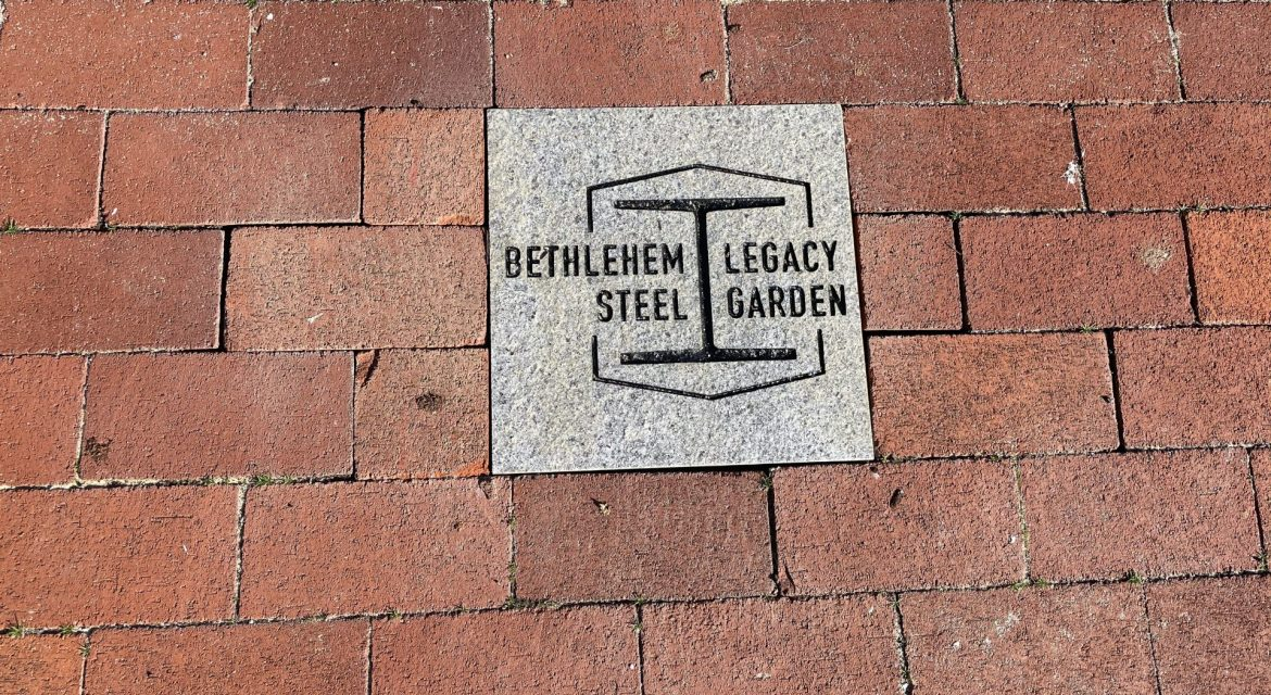 "This photo shows a row of bricks and a commemorative plaque that reads, ""Bethlehem Steel Legacy Garden"""