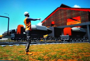 A virtual rendering showing a person outside the steel mill