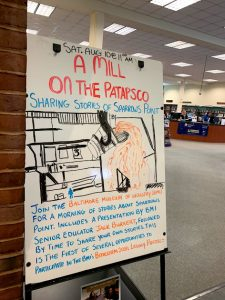 """A hand-drawn sign on a whiteboard advertises a lecture offered by the BMI called, """"A Mill on the Patapsco"""""""